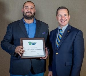George Bou-Saab, left, with ITE President Michael Sanderson, accepts the student chapter award