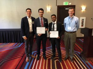 Authors Bijan Vafaei, center left, and Pranamesh Chakraborty, center right, pose with John Brady, left, representing award sponsor Cintra, and Nick Wood, right, chair of student awards and scholarships for the conference. (Photo courtesy of Case Emoto, co-chair, TRB Managed Lane Committee)