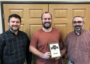 Skylar Knickerbocker, center, won the Young Transportation Professional of the Year award from MOVITE. Tyler Wiles, left, MOVITE - Iowa Director, and Andy Swisher, right, MOVITE Vice President, presented Knickerbocker with a plaque this week.