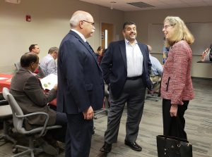 Iowa DOT's John Selmer, left, and CTRE Director Omar Smadi, center, talk to ISU President Wendy Wintersteen about the partnership between InTrans and the Iowa DOT.
