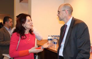 InTrans Associate Scientist Basak Aldemir Bektas talks with Iowa DOT Director Mark Lowe at the celebration.
