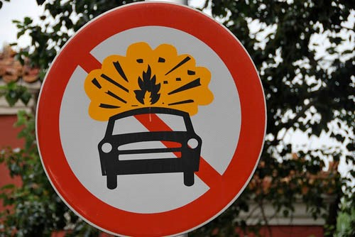 Figure 5. Photo of a road sign with a car on fire in Beijing, China.