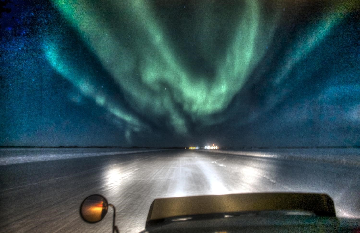 Approaching the northern lights along the ice road
