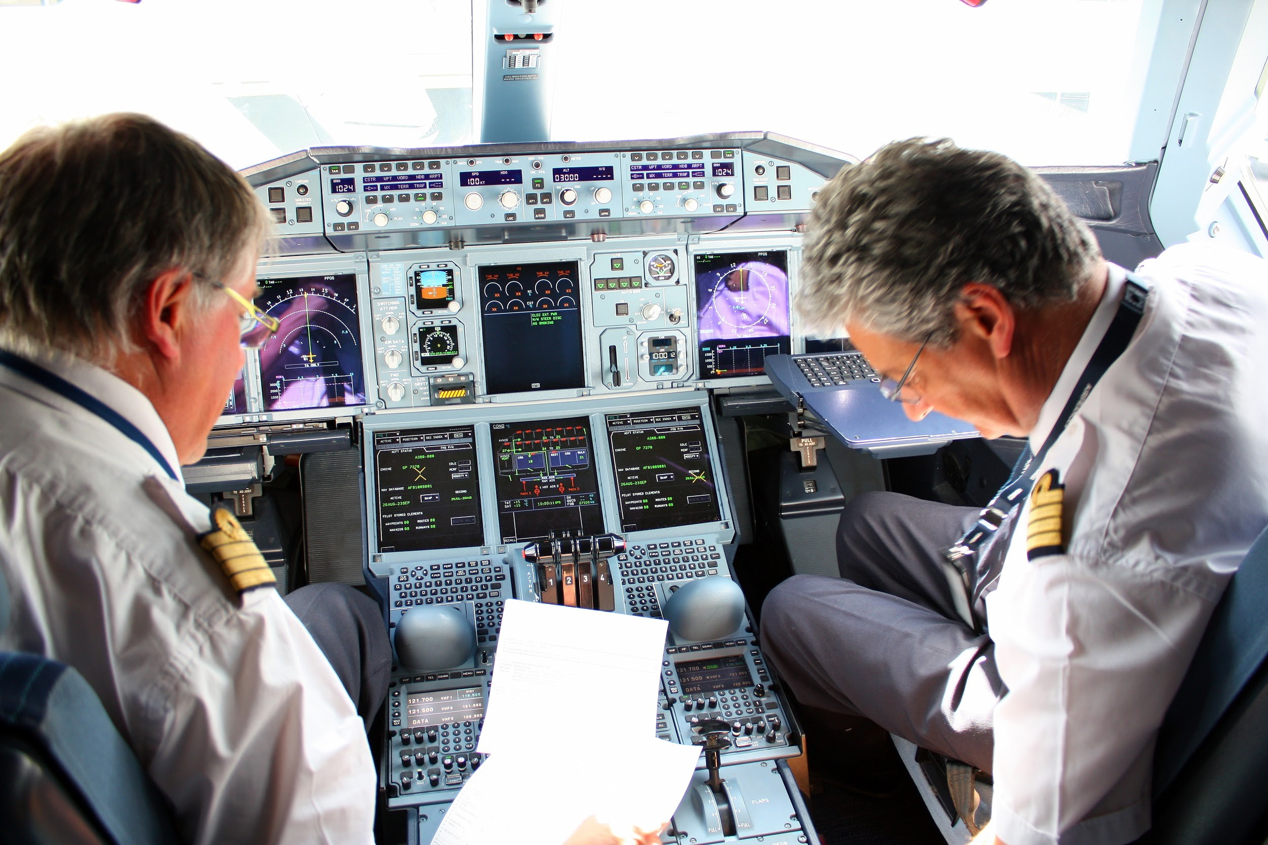 Pilots preparing in the cockpit