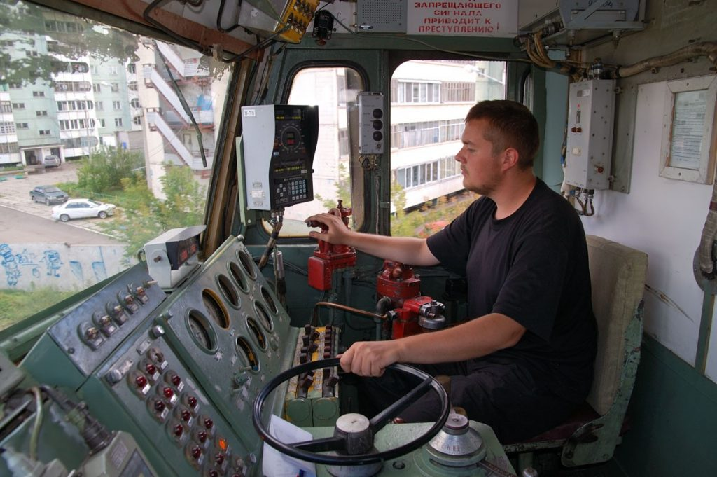 Locomotive engineer operates freight locomotive