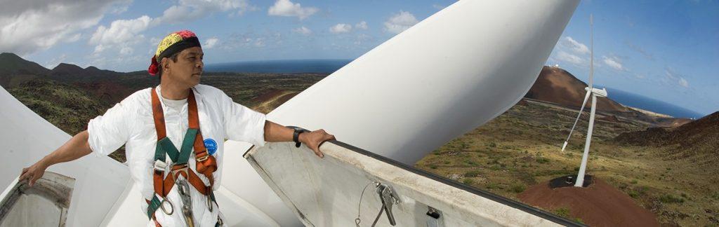 Worker atop a wind turbine