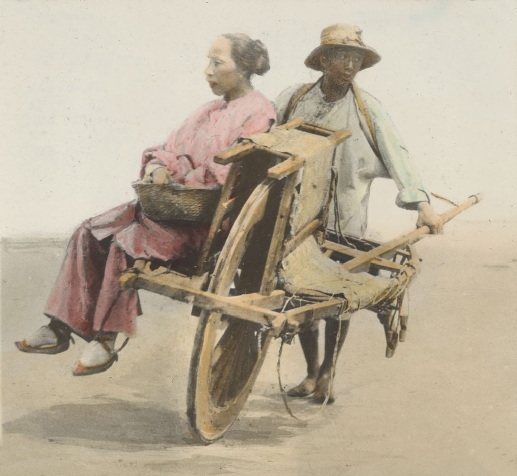 Woman using wheelbarrow for transport, China circa 1895