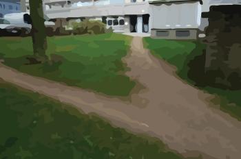 Areas with no sidewalks make pedestrians cross through the grass