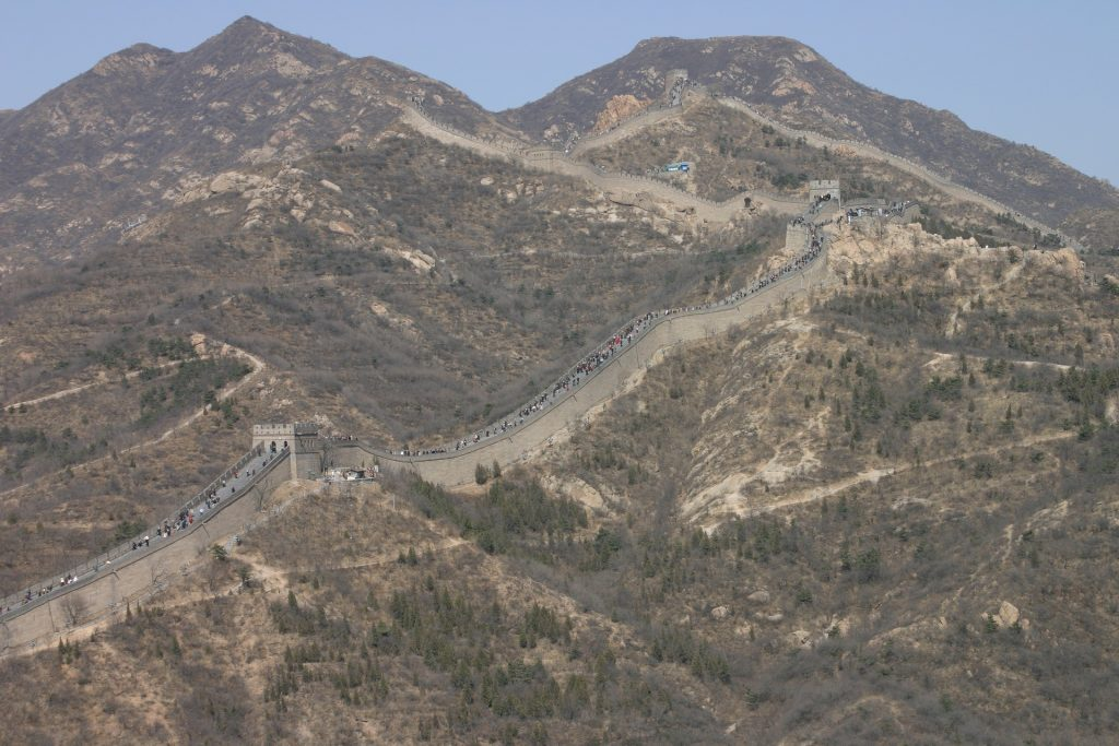 Visitors walking the Great Wall up the mountains