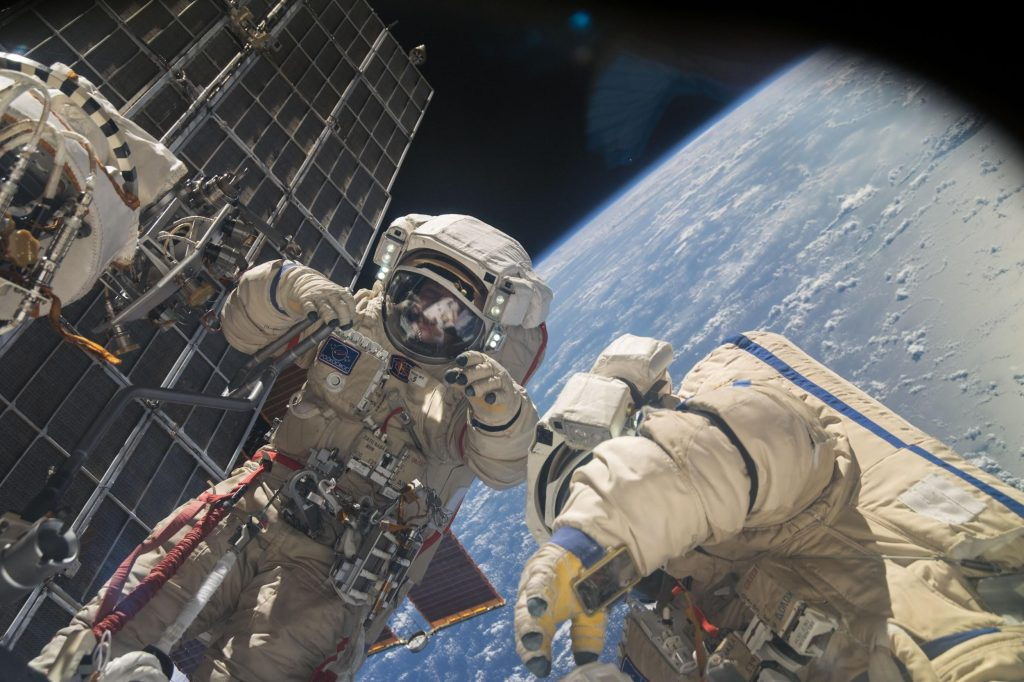 Russian flight engineers perform assembly and maintenance on the ISS