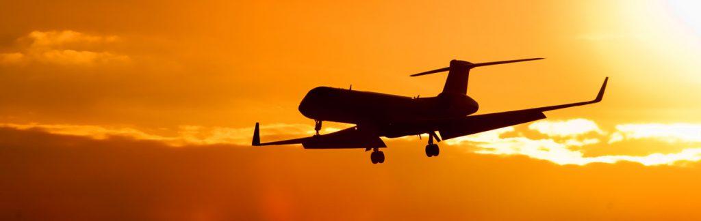 Jet in sunlight sky