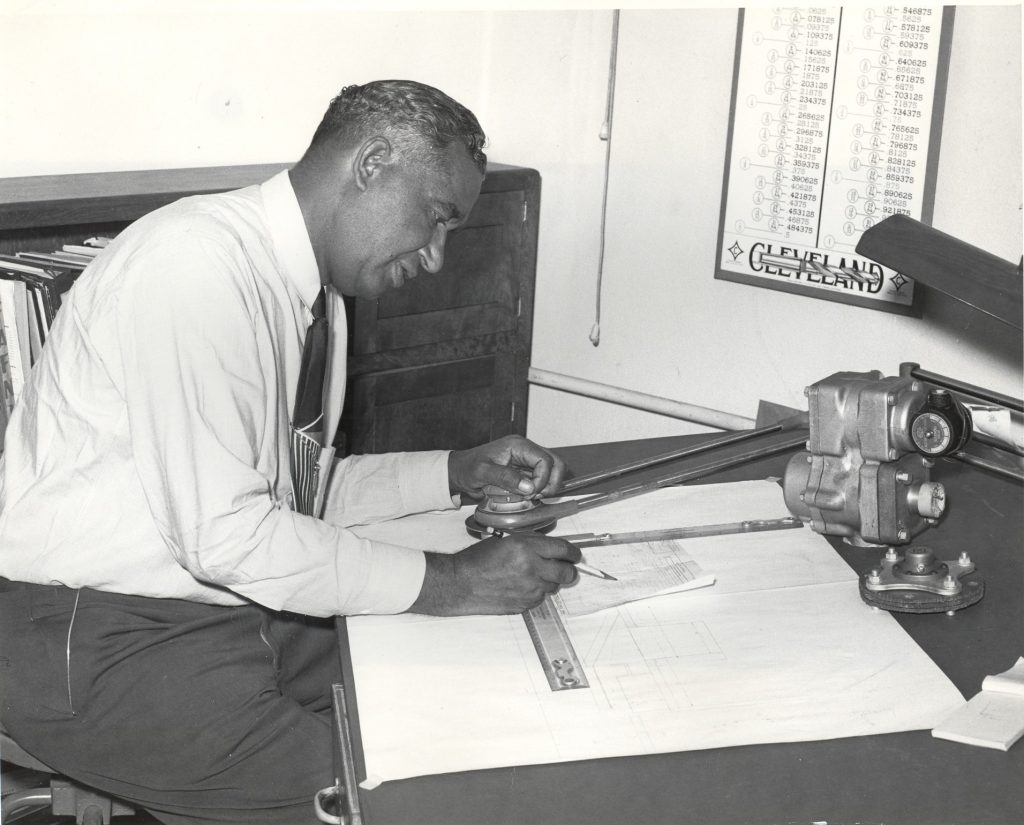 Frederick McKinley Jones at a drafting table