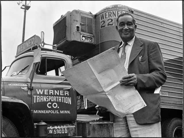 Frederick McKinley Jones standing next to truck outfitted with a mobile refrigeration unit, circa 1950