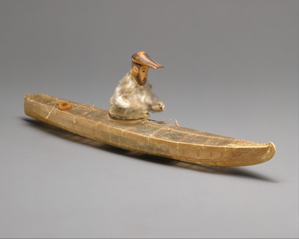 Aleut model of historic vessel and hunter circa 1840s or 1850s