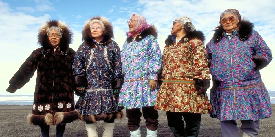 Native Alaskan women in traditional coats