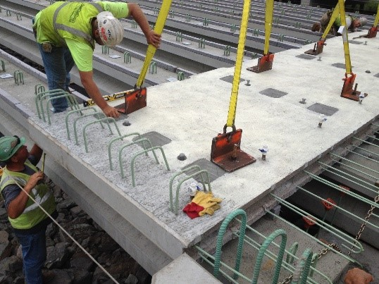Figure 1. A prefabricated deck being placed on bridge girders