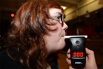Woman taking a breathalyzer test