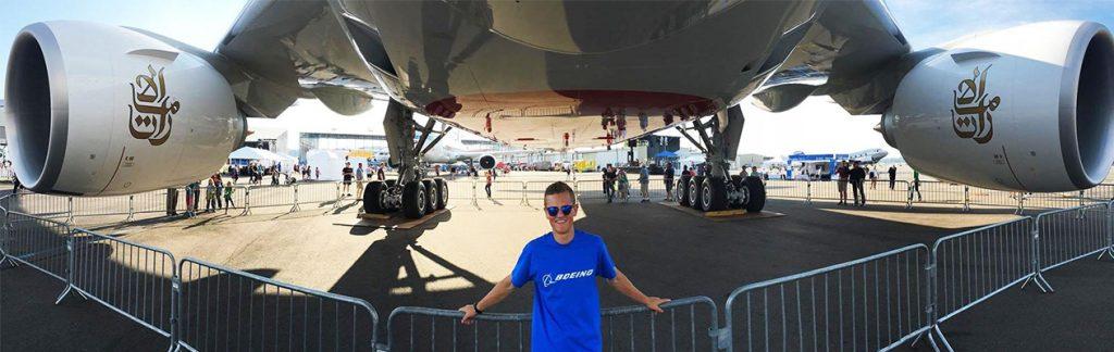 Tyler Oviatt under airplane