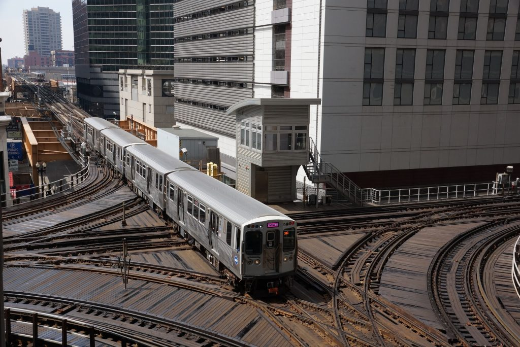 """A Pink Line """"L"""" train passing through Chicago, Illinois"""