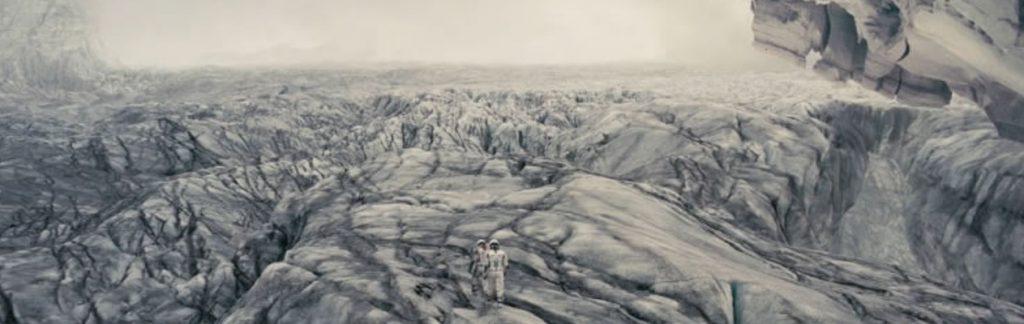 Astronauts on planet landscape