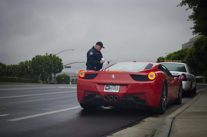 Driver in a red car gets a ticket