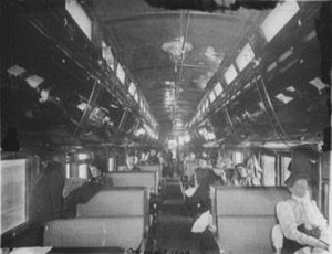 Inside a passenger rail car in the early 1900s