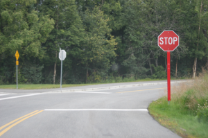 Additional reflective material on stop sign post
