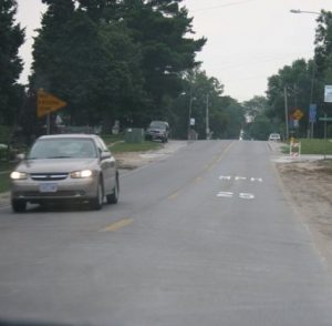 On-pavement speed limit signing on E-18 in Roland, Iowa
