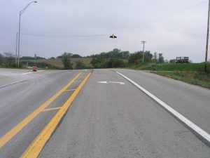 Channelization using a painted center island and left turn lane at a rural intersection in Iowa